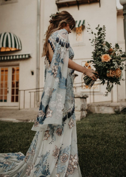 Blue boho floral gown with tassel details