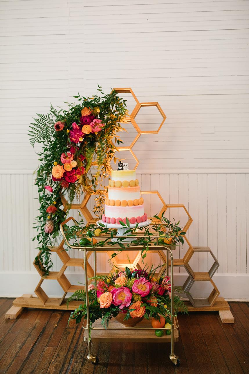 bright colored macaron adorned wedding cake