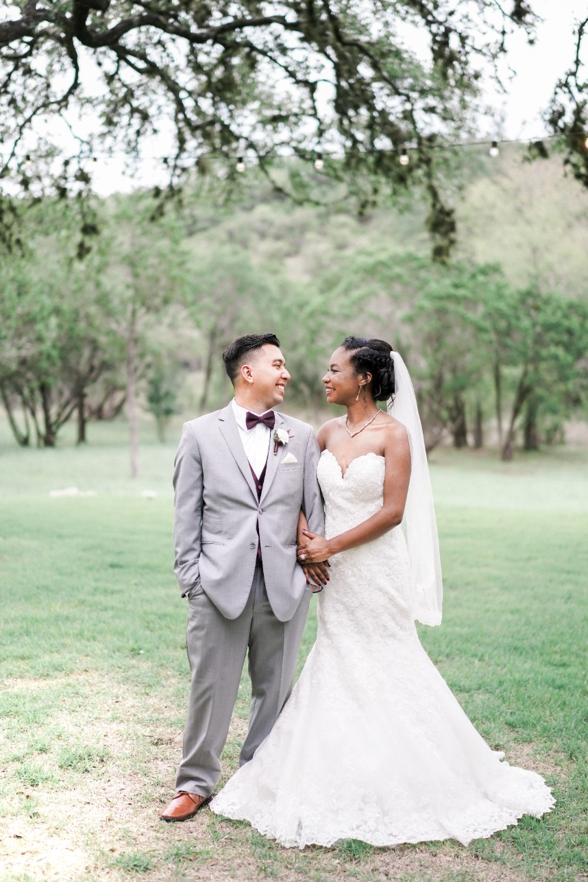 couple standing close together | tips on preparing a shot list for your photographer